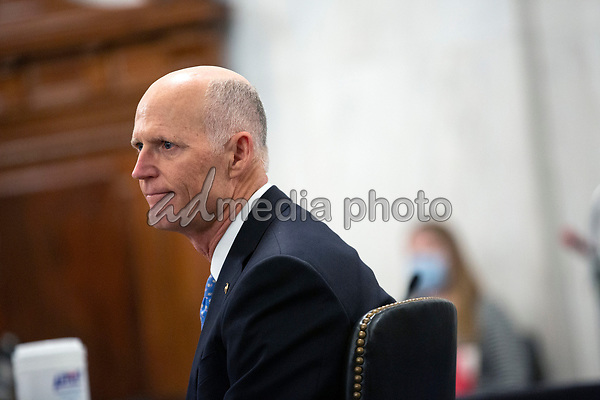 United States Senator Rick Scott (Republican of Florida) listens during a U.S. Senate Committee on Homeland Security and Governmental Affairs meeting in the Senate Russell Office Building in Washington D.C., U.S., on Wednesday, May 20, 2020, to consider a motion to issue a subpoena to Blue Star Strategies.  Credit: Stefani Reynolds / CNP/AdMedia