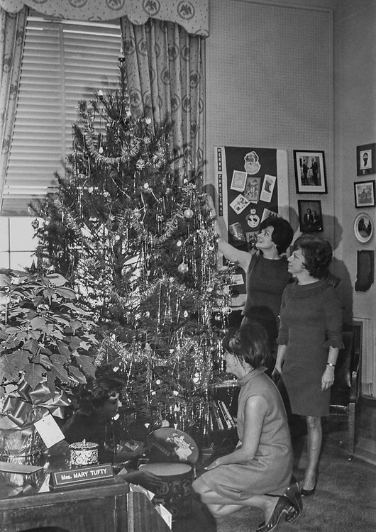 Staff members decorating Christmas tree at Mrs. Mary Tufty's office during Christmas. (Photo by CQ Roll Call via Getty Images)