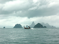 A misty breeze muffled the growling motor of our long-tail boat as we navigated through a dramatic maze of limestone pillars that form an unforgettable ocean landscape in Thailand's Phang Nga Bay. Massive limestone blocks form a collection of more than 40 islands within the 155-square mile Phang Nga Marine National Park. They were created by mainland fault movements and geological shifts dating from a period 10,000 years ago.