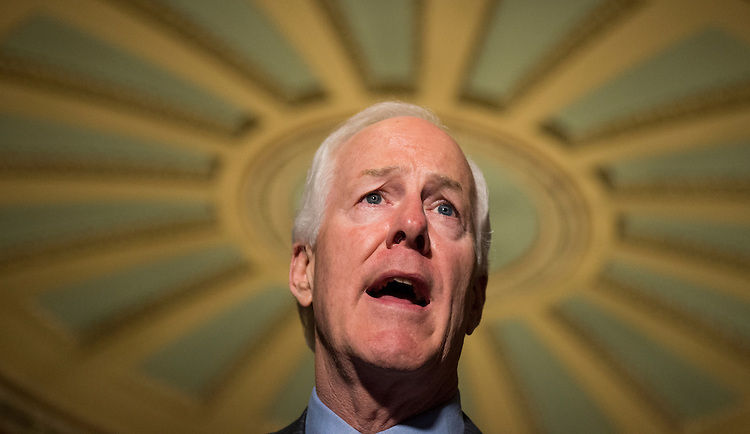 UNITED STATES - SEPTEMBER 9: Sen. John Cornyn, R-Texas, speaks to reporters in the Ohio Clock Corridor of the Capitol following the Senate policy luncheons on Tuesday, Sept. 9, 2014. (Photo By Bill Clark/CQ Roll Call)