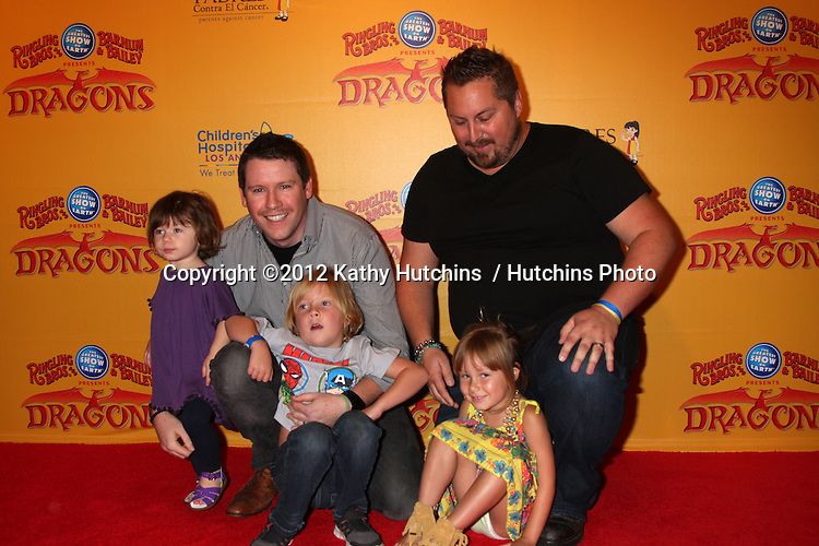 LOS ANGELES - JUL 12:  Bill Horn, Scout Masterson with their daighter in purple, and Tori Spelling's children in front of them arrives at 'Dragons' presented by Ringling Bros. & Barnum & Bailey Circus at Staples Center on July 12, 2012 in Los Angeles, CA
