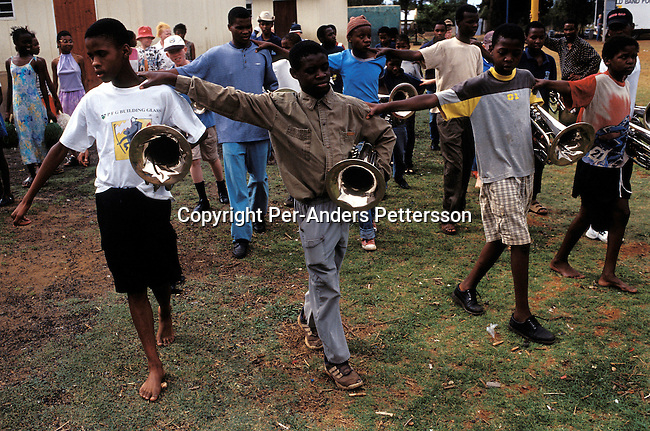dieduca00254 Education/ Disable/ Blind KLIPRIVER, SOUTH AFRICA APRIL 13: (GERMANY OUT) Aubrey Gaanakgomo, age 15, John Milolo, age 14, Sicelo Kunene, age 14, Goodboy Matimane, age 17, are all blind children practicing in a brass band at Sibonile (means: we have seen) School at Sibonile (means: we have seen) School for the Blind on April 13, 2003 at Sibonile (means: we have seen) School for the Blind in Klipriver, south of Johannesburg, South Africa. A Johannesburg music group visits them about once a month giving the children a chance to play instruments and dance. A blind woman founded the school in 1994. The school has about 125 students from disadvantaged communities around South Africa. Many of the children have faced rejection from their families and communities, and at Sibonile they have a chance for a good education. .(Photo: Per-Anders Pettersson/iAfrika Photos)....