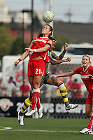 Brittany Bock (21) of the Western New York Flash, left and Tasha Kai (00) of the Philadelphia Independence go up for a header. The Western New York Flash defeated the Philadelphia Independence 5-4 on penalty kicks after overtime following a 1-1 tie in the Women's Professional Soccer (WPS) Championship game at Sahlen's Stadium in Rochester, NY August 27, 2011.