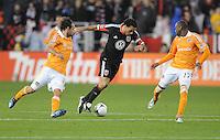 D.C. United forward Dwyane De Rosario (7) goes against Houston Dynamo midfielder Adam Loffat (16) left and midfielder Luis Camargo (17) D.C. United defeated The Houston Dynamo 3-2 at RFK Stadium, Saturday April 28, 2012.