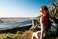 A woman at Waiho Beach near Franz Josef Glacier township - Westland National Park, West Coast, New Zealand