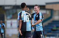 Garry Thompson of Wycombe Wanderers with Aaron Amadi Holloway of Wycombe Wanderers after Wycombe go 3-0 up during the Sky Bet League 2 match between Wycombe Wanderers and York City at Adams Park, High Wycombe, England on 8 August 2015. Photo by Andy Rowland.