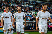 Swansea city mascots  wit the Players ahead of the  Premier League match between Swansea City and Everton played at the Liberty Stadium, Swansea  on September 19th 2015