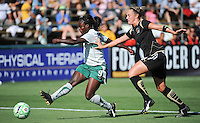 Athletica's Eniola Aluko shoots on goal in front of Kristen Graczyk, right, St. Louis Athletica over FC Gold Pride 1-0 at Buck Shaw Stadium, in Santa Clara, California, Sunday, July 5, 2009.
