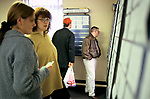 Job Centre young women out of work looking for a job reading vacancy cards. 1998 1990s  Mountain Ash Wales UK