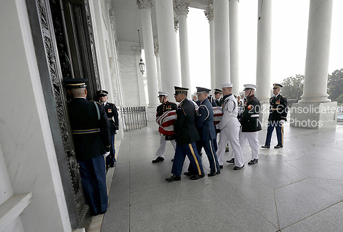 GETTY POOLWASHINGTON, DC - AUGUST 31:  A military honor guard team carries the casket of the late-Sen. John McCain (R-AZ) into the U.S. Capitol August 31, 2018 in Washington, DC. The late senator died August 25 at the age of 81 after a long battle with brain cancer. He will lie in state at the U.S. Capitol today, a rare honor bestowed on only 31 people in the past 166 years. Sen. McCain will be buried at his final resting place at the U.S. Naval Academy on Sunday.  (Photo by Win McNamee/Getty Images)