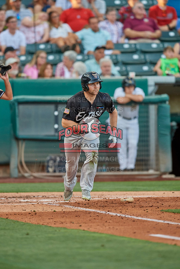 Michael Gettys (7) of the El Paso Chihuahuas hustles to first base against the Salt Lake Bees at Smith's Ballpark on August 17, 2019 in Salt Lake City, Utah. The Bees defeated the Chihuahuas 5-4. (Stephen Smith/Four Seam Images)