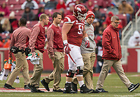 Hawgs Illustrated/BEN GOFF <br /> Trainers help Hjalte Froholdt, Arkansas left guard, off the field with an injury in the first half against Mississippi State Saturday, Nov. 18, 2017, at Reynolds Razorback Stadium in Fayetteville.