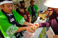 "A stall at the B1 Grand Prix, Yokote, Akita Pref, Japan, September 19 2009. The B1 Grand Prix is a competition for inexpensive and tasty regional dishes from around Japan. The B stands for ""b-class gourmet"". In 2009 it was held in the northern Japan city of Yokote."