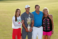 Brooks Koepka (USA) poses for a photo with his girlfriend Jena Sims and his parents after winning the 118th U.S. Open Championship at Shinnecock Hills Golf Club in Southampton, NY, USA. 17th June 2018.<br /> Picture: Golffile | Brian Spurlock<br /> <br /> <br /> All photo usage must carry mandatory copyright credit (&copy; Golffile | Brian Spurlock)