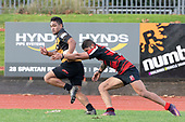 Onni Mesake looks to stop Taimua Malielegaoi. Counties Manukau Premier Club Rugby game between Papakura and Bombay, played at Massey Park Papakura on Saturday June 16th 2018. Bombay won the game 36 - 17 after leading 17 - 7 at halftime.<br /> Papakura Ray White 17 - Kris Smithson 2, Taafaga Tagaloa tries, Monty Punatai conversion.<br /> Bombay 36 - Jordan Goldsmith, Haamiora Clarke 2, Patrick Masoe, Mitchell Thackham, Chay Mackwood tries, Jordan Goldsmith 2, Ki<br /> Anufe conversions.<br /> Photo by Richard Spranger.