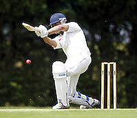 Sneh Shah goes on the attack for Wembley during the Middlesex County Cricket League Division Three game between Wembley and North London at Vale Farm, Wembley on Sat May 31, 2014