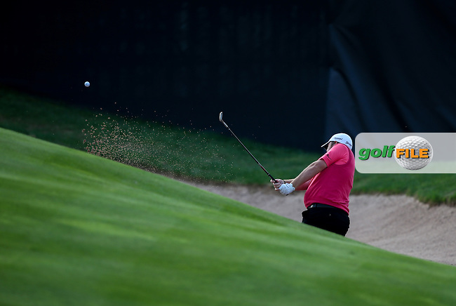 Shane Lowry (IRL) finds the bunker on the last during Round Three of the ISPS Handa Wales Open 2014 from the Celtic Manor Resort, Newport, South Wales. Picture:  David Lloyd / www.golffile.ie