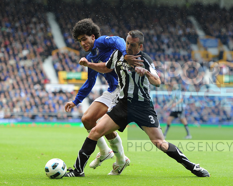 Marouane Fellaini of Everton and Jose Enrique of Newcastle United