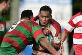 W. Setitaia gets hit in a strong tackle by R. Garmonsway. Counties Manukau Premier McNamara Cup Semi Final rugby game between Karaka & Waiuku, played at  Karaka on 28th July 2007. Karaka won 18 - 15.