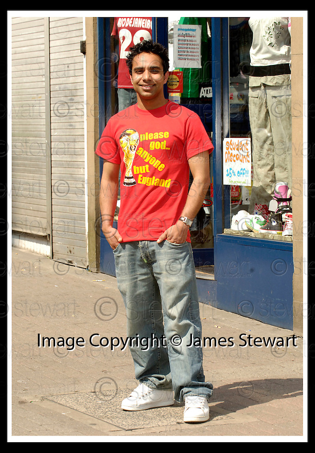 09/06/2006        Copyright Pic: James Stewart.File Name : sct_jspa03_shirt.GUDDU KHAN WITH THE WORLD CUP T-SHIRT ON SALE AT HIS STIRLING SHOP.....Payments to :.James Stewart Photo Agency 19 Carronlea Drive, Falkirk. FK2 8DN      Vat Reg No. 607 6932 25.Office     : +44 (0)1324 570906     .Mobile   : +44 (0)7721 416997.Fax         : +44 (0)1324 570906.E-mail  :  jim@jspa.co.uk.If you require further information then contact Jim Stewart on any of the numbers above.........