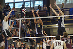 27 APR 2014: Kameron Beans (11) and Chad Albert (9) of Juniata College block against Springfield College during the Division III Men's Volleyball Championship held at the Kennedy Sports Center in Huntingdon, PA. Springfield defeated Juniata 3-0 to win the national title.  Mark Selders/NCAA Photos