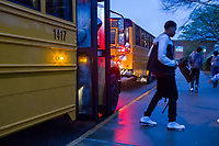 Students get off the bus at Vernon Malone College and Career Academy in Raleigh, NC on Friday, March 31, 2017. (Justin Cook for The Wall Street Journal)<br /> <br /> BUSES Summary<br /> A shortage of school bus drivers is forcing one of North Carolina&rsquo;s largest school districts to consider starting class as early as 7:10 a.m. and as late as 9:15 a.m. this fall, to give the limited number of drivers time to do three or more runs each morning.