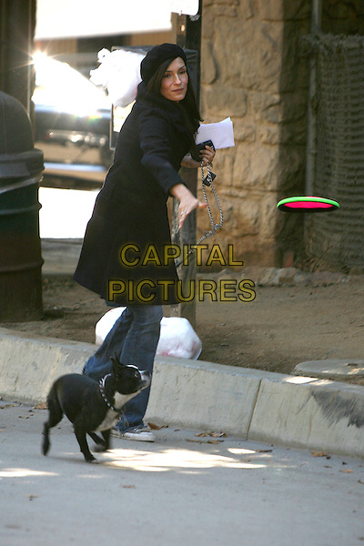 "FAMKE JANSSEN and her dog Licorice.Famke Janssen Unveils ""Be An Angel For Animals"" PETA Ad at Runyon Canyon Park, Hollywood, California, USA,.19 December 2006..full length pet photocall black coat hat walking.CAP/ADM/BP.©Byron Purvis/Admedia/Capital Pictures"
