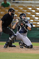 Peoria Javelinas catcher Austin Hedges (11), of the San Diego Padres organization, throws back to the pitcher in front of umpire Hal Gibson III during an Arizona Fall League game against the Glendale Desert Dogs on October 14, 2013 at Camelback Ranch Stadium in Glendale, Arizona.  Glendale defeated Peoria 5-1.  (Mike Janes/Four Seam Images)