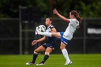 Boston Breakers midfielder Heather O'Reilly (9) passes the ball under pressure from Sky Blue FC defender Caitlin Foord (4). Sky Blue FC and the Boston Breakers played to a 0-0 tie during a National Women's Soccer League (NWSL) match at Yurcak Field in Piscataway, NJ, on July 13, 2013.