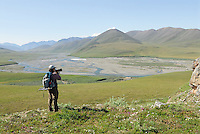 Georgia Bennett prepares to photograph the scenery along the Kongakut River, in Alaska's Arctic National Wildlife Refuge.