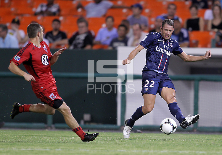 WASHINGTON, DC - July 28, 2012:  Chris Kolb (22) of DC United watches a pass by Sylvain Armand (22) of PSG (Paris Saint-Germain) in an international friendly match at RFK Stadium in Washington DC on July 28. The game ended in a 1-1 tie.