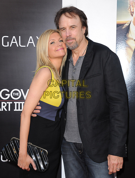 "Susan Yeagley & Kevin Nealon.""The Hangover Part III"" Los Angeles Premiere held at the Westwood Village Theater, Los Angeles, California, USA..May 20th, 2013.half length husband wife yellow blue dress clutch bag arm around waist married grey gray black goatee facial hair shirt.CAP/DVS.©DVS/Capital Pictures"