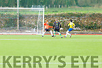 Classic FC keeper Pa Bailey and Ronan Lucey forces Daniel Collins of Kilmoyley United to miss the target in the Denny league on Sunday