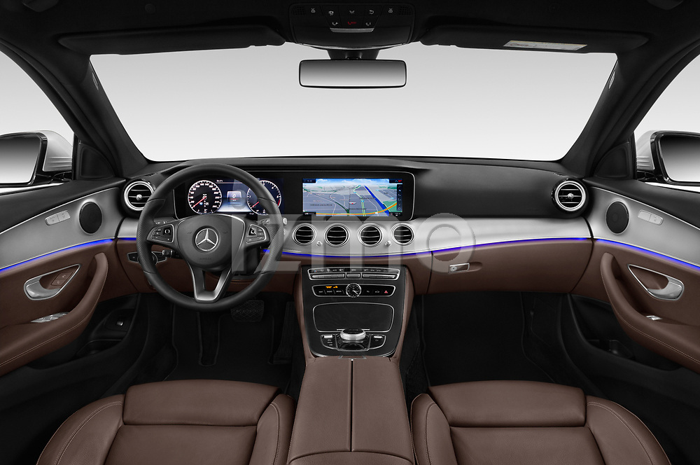 Stock photo of straight dashboard view of a 2018 Mercedes Benz E Class Business Solution 4 Door Sedan