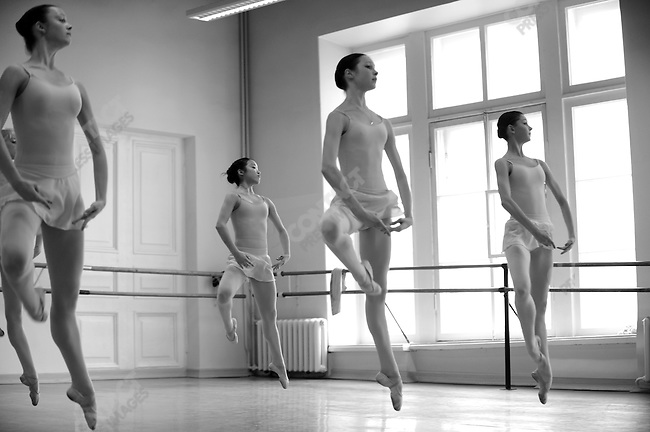 Girls from the eighth year at the Vaganova Ballet Academy in St. Petersburg, including two Japanese students, worked on floor exercises and jumps during a daily class with teacher Irina Sitnikova. March 19, 2009