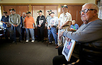 NWA Democrat-Gazette/DAVID GOTTSCHALK  Phillip Ball (right), a Korean War veteran, listens Monday, May 1, 2017, to remarks after receiving a book titled Korea Reborn A Grateful Nation in Fayetteville. Ball was one of a group of nine Korean War veterans that were recognized by the Northwest Arkansas Chapter of Military Officers Association of America Monday and received the book. The books were published by the South Korean government in gratitude of the United States military service in the war and documents the growth and progress that country has sustained over the past 60 years.