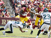 Washington Redskins running back Rob Kelley (20) carries the ball in the second quarter against the Philadelphia Eagles at FedEx Field in Landover, Maryland on Sunday, September 10, 2017.  Philadelphia Eagles defensive back Patrick Robinson (21) tries to make the tackle and Eagles free safety Rodney McLeod (23) defends on the play.  Washington Redskins tight end Jordan Reed (86) is visible in the photo as well.<br /> Credit: Ron Sachs / CNP