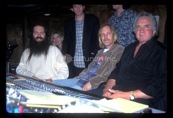 "LOS ANGELES, CA :  JOHNNY CASH, Tom Petty, Mike Campbell, Marty Stuart , Benmont Tench, June Carter Cash and Rick Rubin photographed during the recording sessions for Johnny Cash's ""Unchained"" CD Produced by Rick Rubin. Photographed at Sound City Studios in Van Nuys, CA USA - January 26, 1996. Photo © Kevin Estrada / Media Punch"