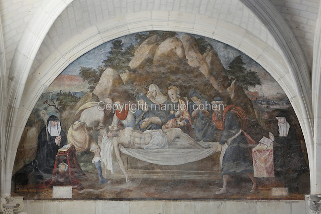 Entombment fresco, Chapter House, Fontevraud Abbey, Fontevraud-l'Abbaye, Loire Valley, Maine-et-Loire, France. The Chapter House was built in the 16th century and its walls were painted in 1563 with frescoes of scenes from Christ's Passion by the Anjou artist Thomas Pot. Here we see Christ's body at the entombment and contemporary portraits nuns linked to Fontevraud. The abbey itself was founded in 1100 by Robert of Arbrissel, who created the Order of Fontevraud. It was a double monastery for monks and nuns, run by an abbess. Picture by Manuel Cohen