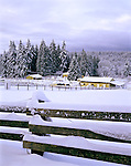 Vashon, WA      <br /> Newly fallen snow covers the fences, pastures and trees of a horse farm in Judd Creek Valley