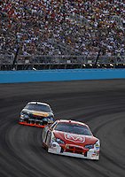 Apr 22, 2006; Phoenix, AZ, USA; Nascar Nextel Cup driver Kasey Kahne of the (9) Dodge Dealers/UAW Dodge Charger leads Martin Truex Jr. during the Subway Fresh 500 at Phoenix International Raceway. Mandatory Credit: Mark J. Rebilas-US PRESSWIRE Copyright © 2006 Mark J. Rebilas..