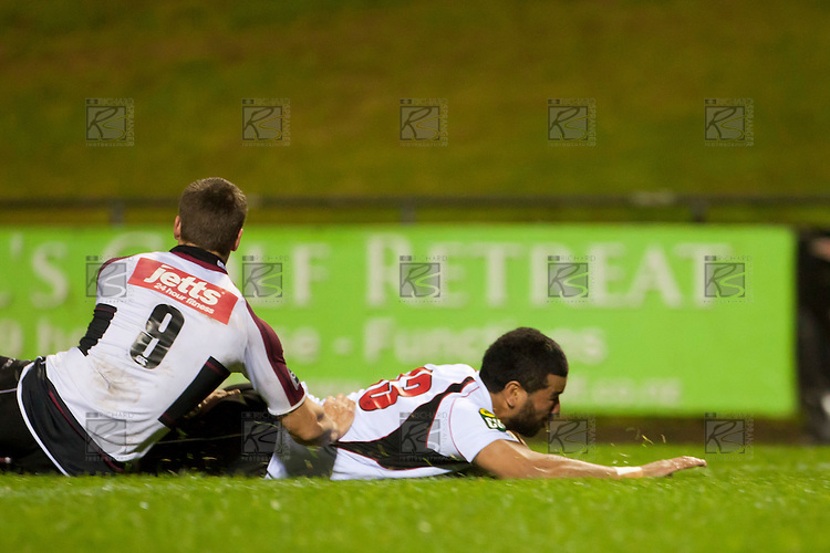 Siale Piutau slides over in the corner to score the Steelers first try. Counties Manukau Steelers pre season ITM Cup game against North Harbour played at Bayer Growers Stadium Pukekohe on Wednesday July 21st 2010..North Harbour won 22 - 21.
