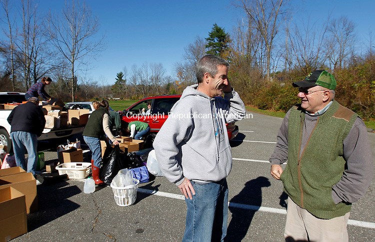 Litchfield, CT-04 November 2012-110412CM04-   John McKenna, left and Dick Dauphinais of Litchfield, organize transportation for the donated goods they collected at the Litchfield Town Hall Sunday afternoon in Litchfield.  McKenna who organized a relief effort to aid victims of Hurricane Sandy was assisted by Dauphinais and Billy Neller, as well as numerous volunteers.  Items including, non-perishable food, water, clothing and toiletries will be driven down to Staten Island, NY to aid those affected by Hurricane Sandy on Monday morning.  A constant flow of donators made their way through the parking lot to drop off goods.    Christopher Massa Republican-American