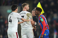 Tempers flair between Burnley's Jack Cork, Charlie Taylor and Crystal Palace's Wilfried Zaha<br /> <br /> Photographer Ashley Crowden/CameraSport<br /> <br /> The Premier League - Crystal Palace v Burnley - Saturday 13th January 2018 - Selhurst Park - London<br /> <br /> World Copyright &copy; 2018 CameraSport. All rights reserved. 43 Linden Ave. Countesthorpe. Leicester. England. LE8 5PG - Tel: +44 (0) 116 277 4147 - admin@camerasport.com - www.camerasport.com