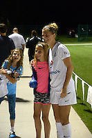 Kansas City, MO - Saturday May 28, 2016: FC Kansas City defender Katie Bowen (21) poses with a fan after the game. FC Kansas City defeated Orlando Pride 2-0 during a regular season National Women's Soccer League (NWSL) match at Swope Soccer Village.