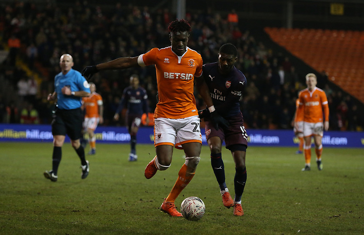 Blackpool's Armand Gnanduillet shields the ball from Arsenal's Ainsley Maitland-Niles<br /> <br /> Photographer Stephen White/CameraSport<br /> <br /> Emirates FA Cup Third Round - Blackpool v Arsenal - Saturday 5th January 2019 - Bloomfield Road - Blackpool<br />  <br /> World Copyright &copy; 2019 CameraSport. All rights reserved. 43 Linden Ave. Countesthorpe. Leicester. England. LE8 5PG - Tel: +44 (0) 116 277 4147 - admin@camerasport.com - www.camerasport.com