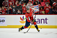 """WASHINGTON, DC - NOVEMBER 03: Capitals left wing Alexander Alex Ovechkin (8) practices one-timers from """"his spot"""" on the left face-off circle while children watch along the glass before the Calgary Flames vs. Washington Capitals on November 3, 2019 at Capital One Arena in Washington, D.C.. (Photo by Randy Litzinger/Icon Sportswire)"""