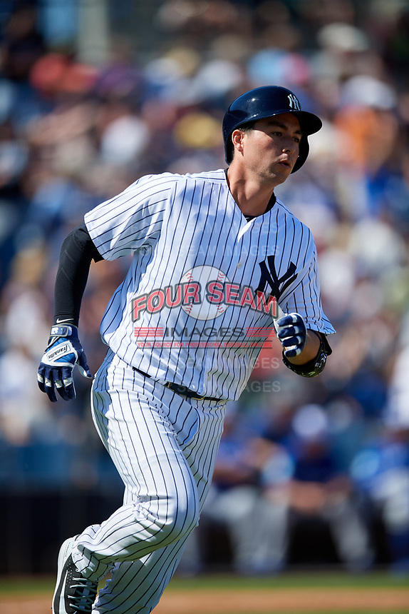 New York Yankees catcher Kyle Higashioka (66) runs to first base after hitting a home run during a Grapefruit League Spring Training game against the Toronto Blue Jays on February 25, 2019 at George M. Steinbrenner Field in Tampa, Florida.  Yankees defeated the Blue Jays 3-0.  (Mike Janes/Four Seam Images)
