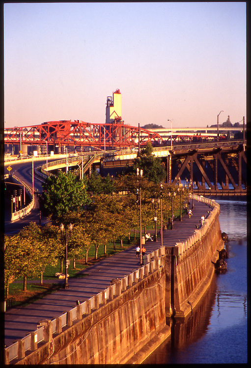 Portland's Waterfront Park runs North and South along the Willamette River and includes a pedestrian walkway.
