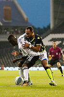 Bristol Rovers' Byron Moore and Fulham's Steven Sessegnon tangle during the Carabao Cup match between Fulham and Bristol Rovers at Craven Cottage, London, England on 22 August 2017. Photo by Carlton Myrie.